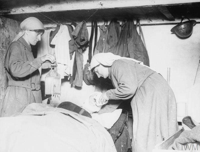 Mairi Chisholm and Elsie Knocker tending to a wounded Belgian soldier in their First Aid Post at Pervyse, 6th August 1917; © IWM (Q 105938)