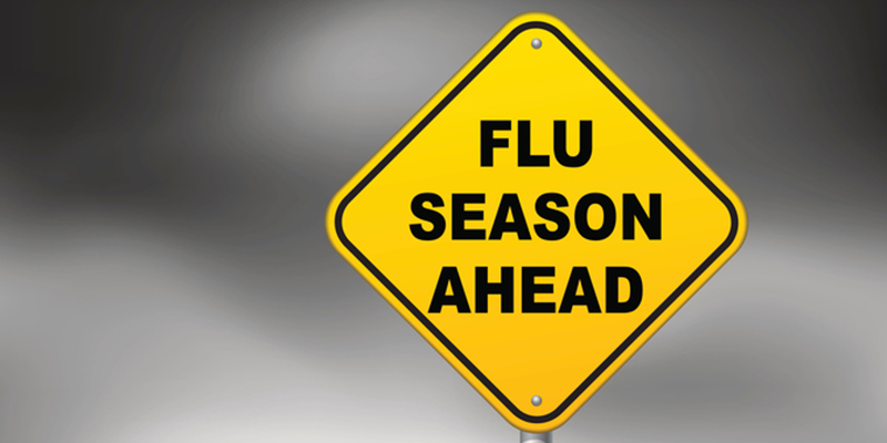 Road sign with 'Flu season ahead' written on it