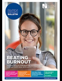 Cover of Bulletin November issue with student member Hollie holding out her phone