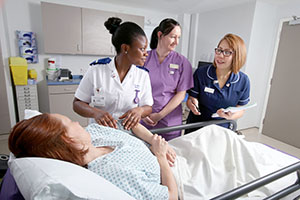 nursing staff by patient's bedside