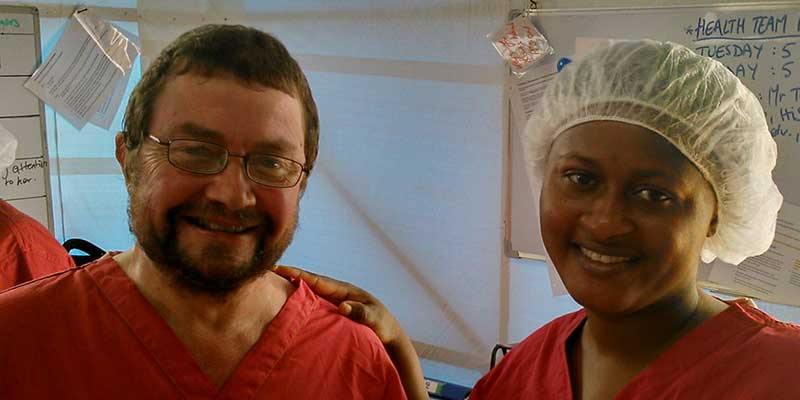 Malcolm Chalk with a colleague at the Ebola Treatment Centre in Kerry Town, Sierra Leone
