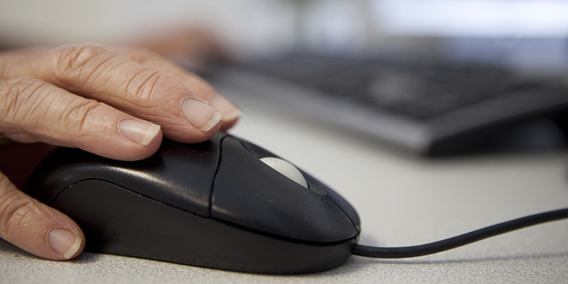 Close up of a hand on a computer mouse