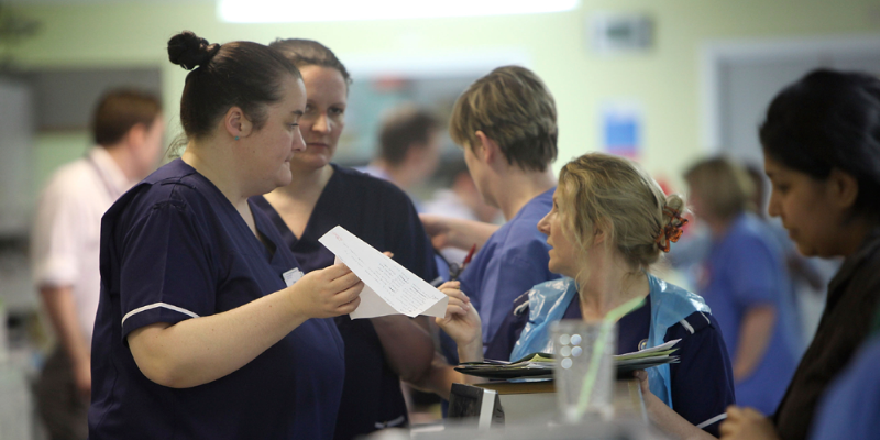 Nurses talking in a busy workplace