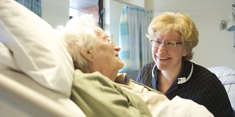 Nurse caring for an older patient