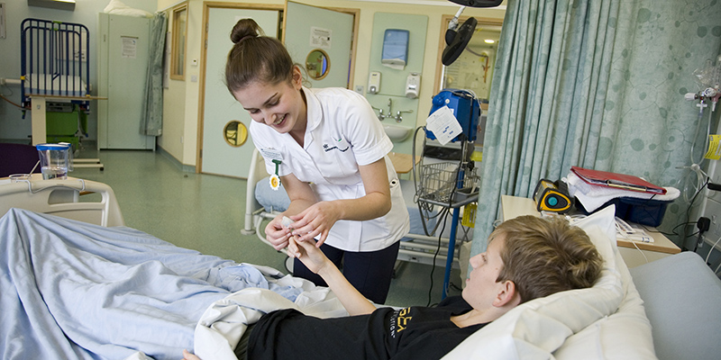 Nursing student caring for a young patient