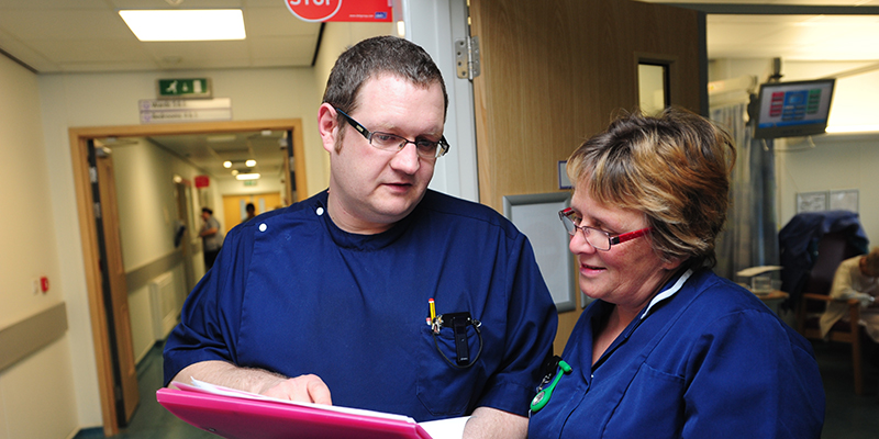 Nurses looking at a patient file