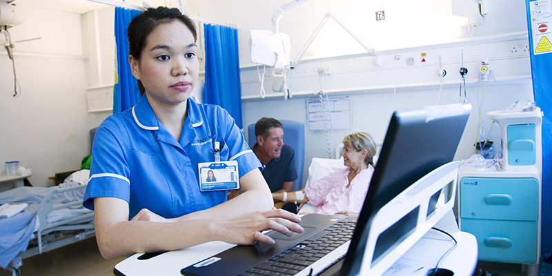 Nurse monitoring a computer in a ward