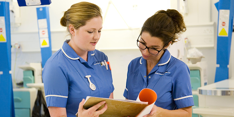 Two nurses talking to each other