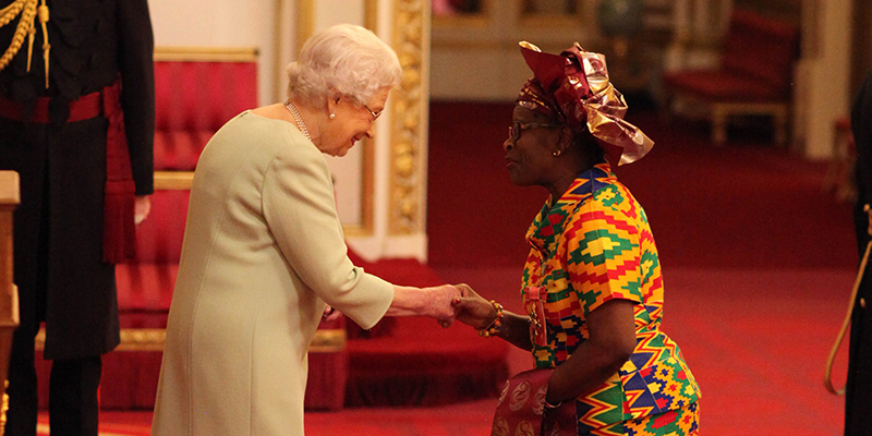 Cecilia Anim receiving her CBE from the Queen