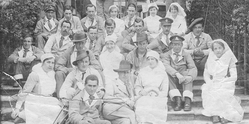 Black and white photo of some nurses with soldiers