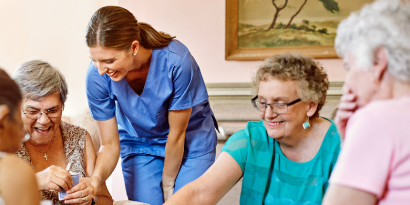 Nurse and residents in care home