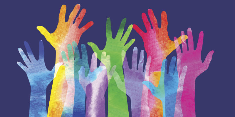Colourful hands held up