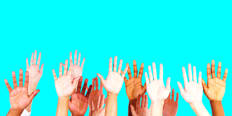 A group of hands stretched up in the air