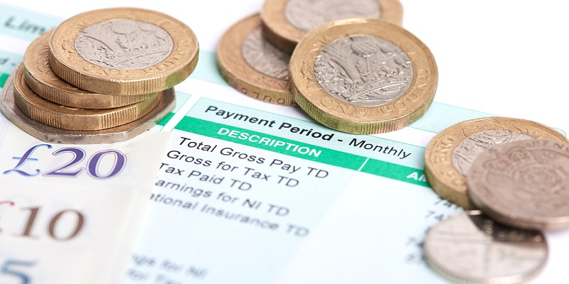 payslip and coins