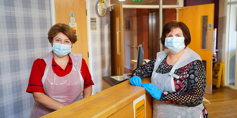 care home staff wearing PPE