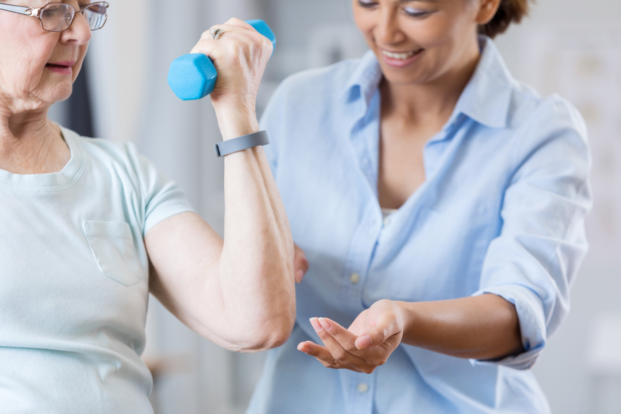 elderly lady exercising with nurse