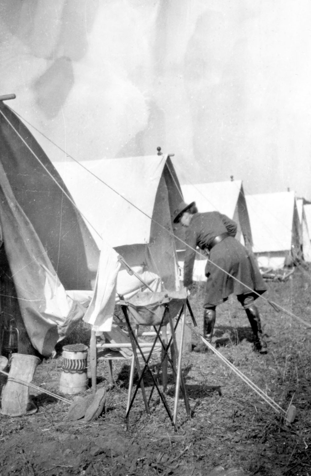 A field of tents with an orderly and washstand in the foreground, possibly in Medjidia the Russian HQ of the Scottish Women's Hospitals in the Dobrudja district of Romania.