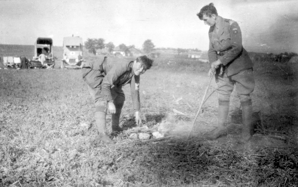 Scottish Women's Hospitals orderlies cooking in field, Romania.